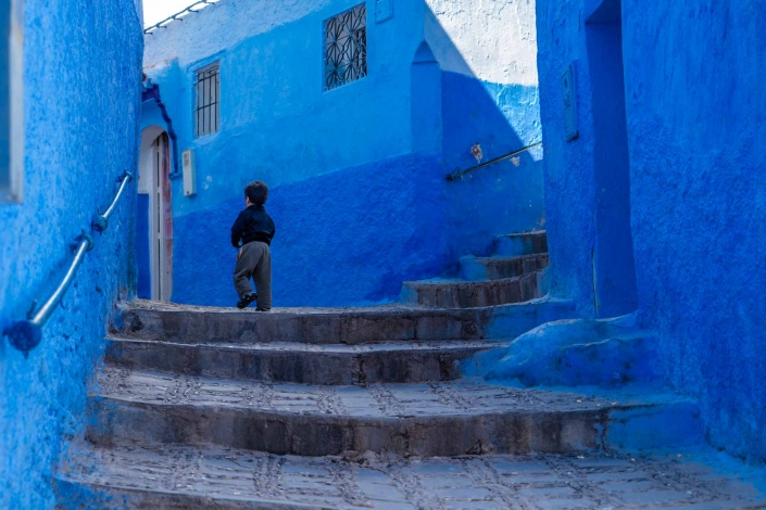 World PescArt Photo - Running from McCurry, Chefchaouen, Morocco