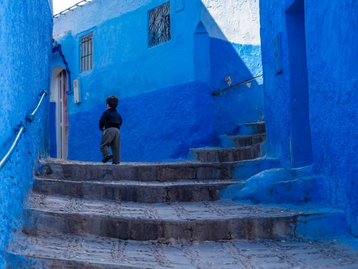 Morocco Chefchaouen - Running from Steve McCurry