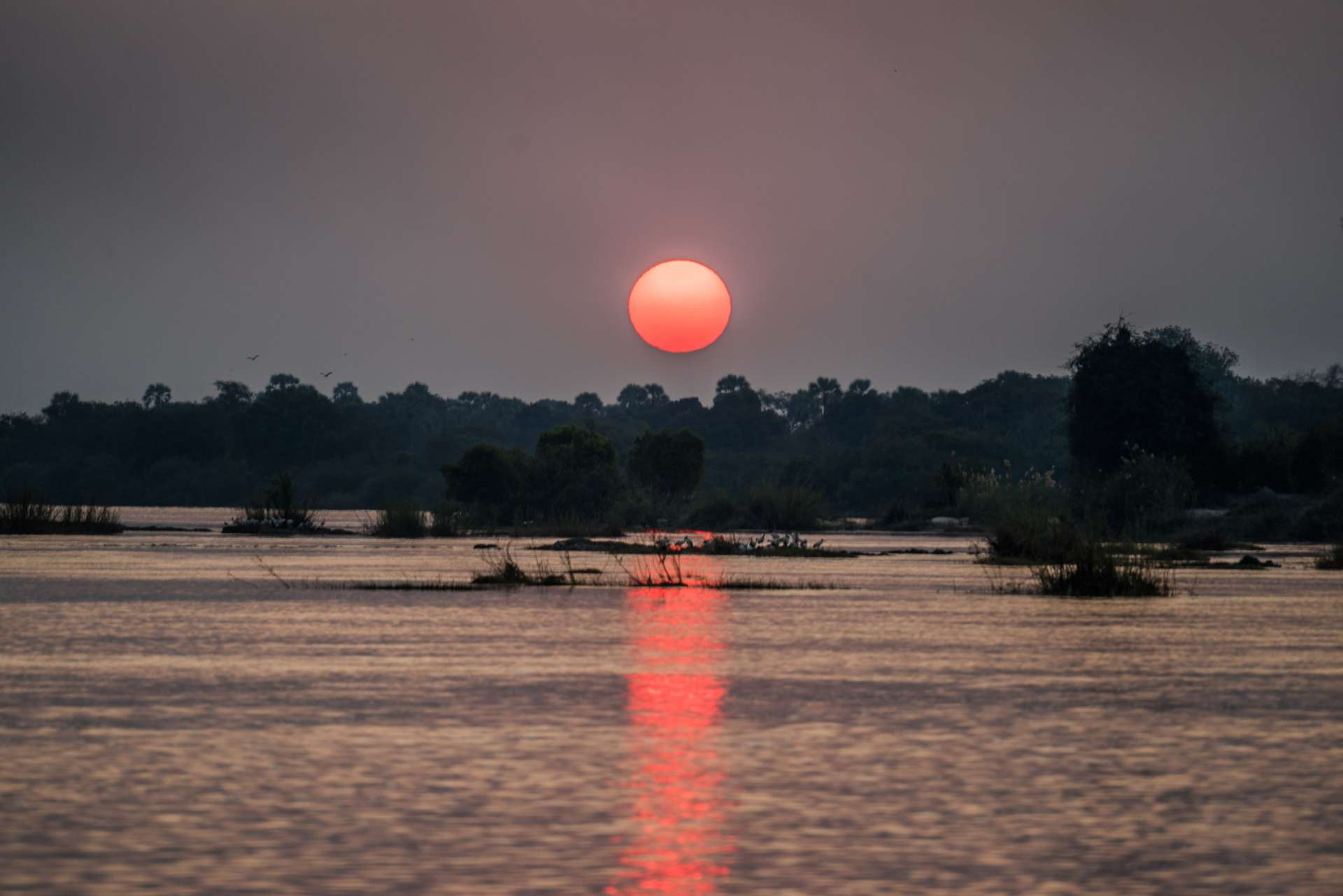 Victoria Falls Zimbawe Enrico Pescantini Travel river cruise sunset