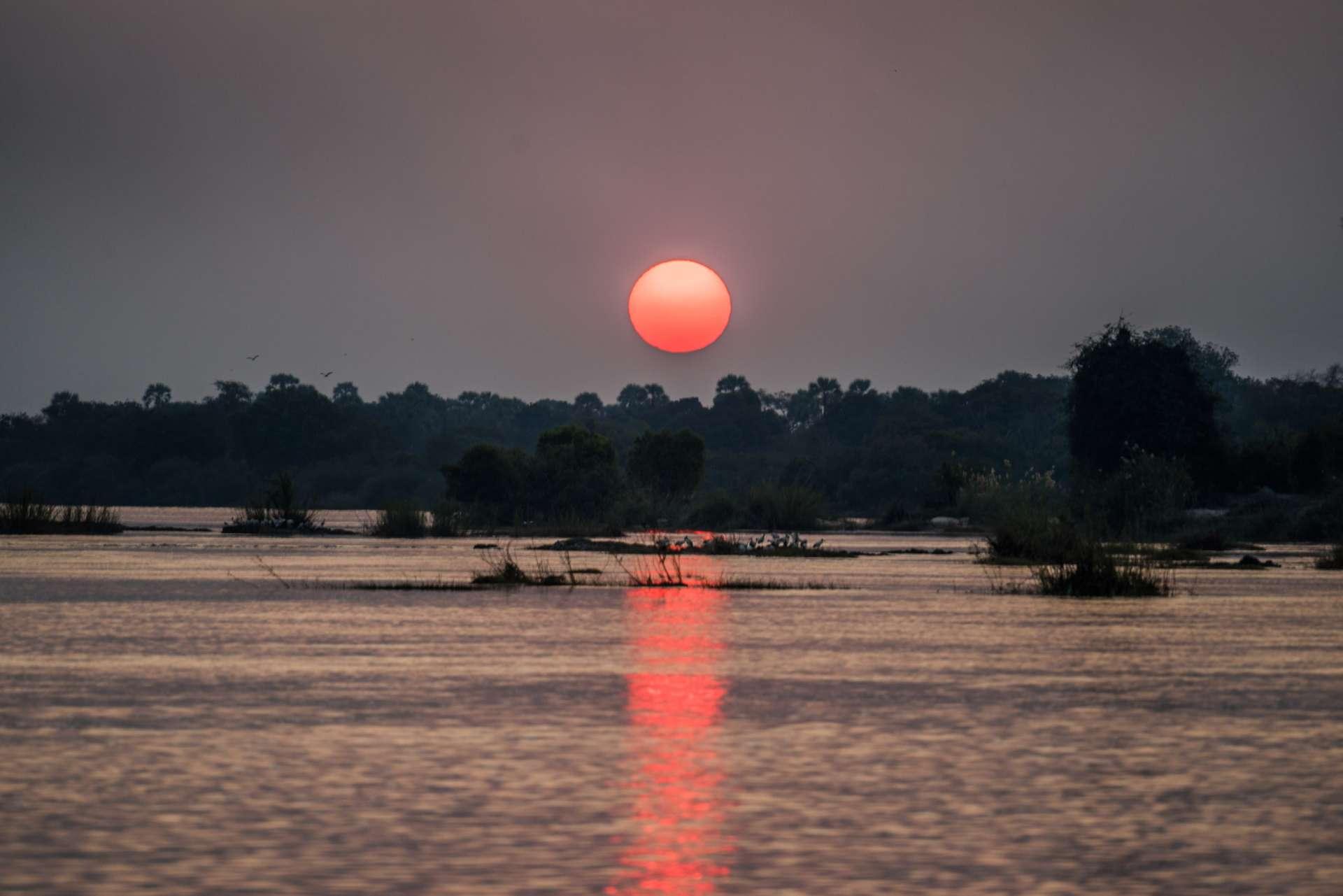 Victoria Falls Zimbawe Enrico Pescantini Travel river cruise sunset