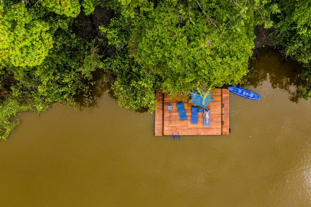 amazon forest iquitos peru drone aerial view lodge sunbathing