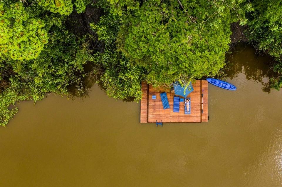 amazon forest iquitos peru muyuna lodge drone aerial view lodge sunbathing