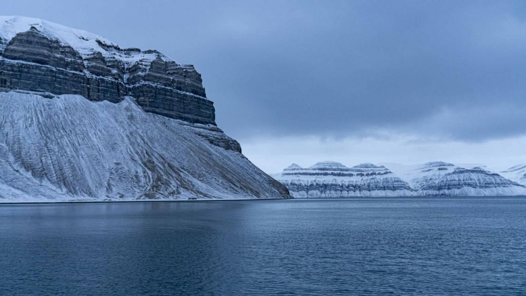 svalbard cruise fjord mountain winter