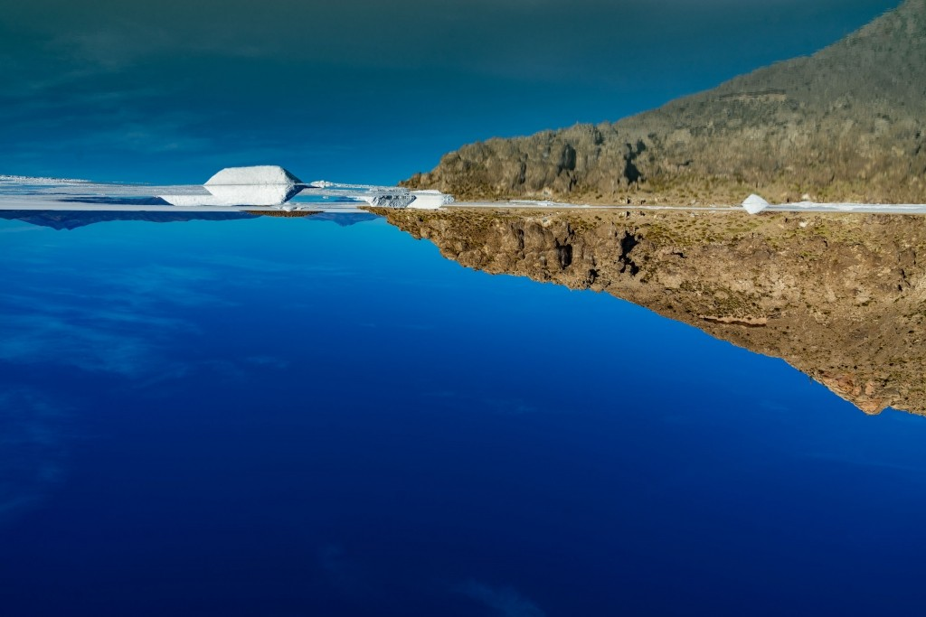 Salar de Uyuni Bolivia world largest salt flat aerial view mirroring effect