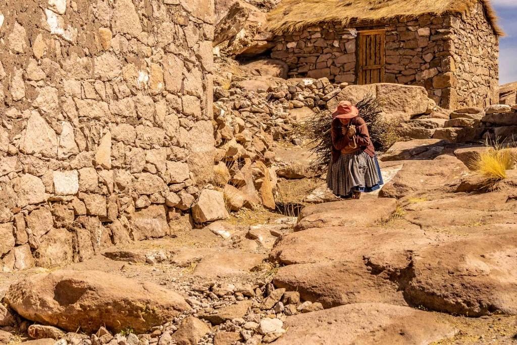 Salar de Uyuni Bolivia world largest salt flat stone village old lady