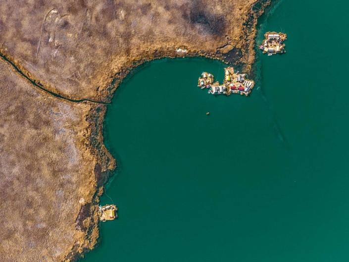 Uros Floating Islands Titicaca Lake Puno Peru aerial drone shot