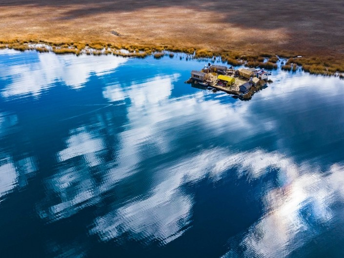 Uros Floating Islands Titicaca Lake Puno Peru aerial drone shot 2