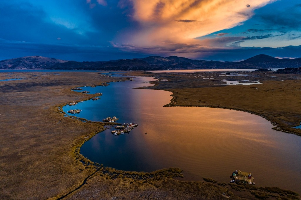 Uros Floating Islands Titicaca Lake Puno Peru aerial drone shot sunset