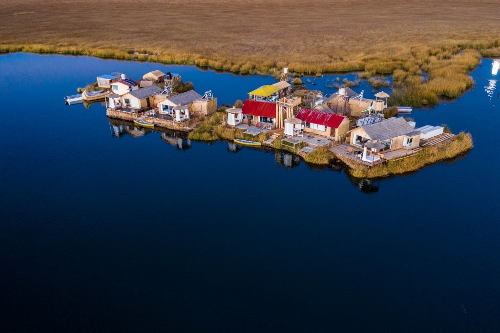 Uros Floating Islands Titicaca Lake Puno Peru aerial drone shot lodge