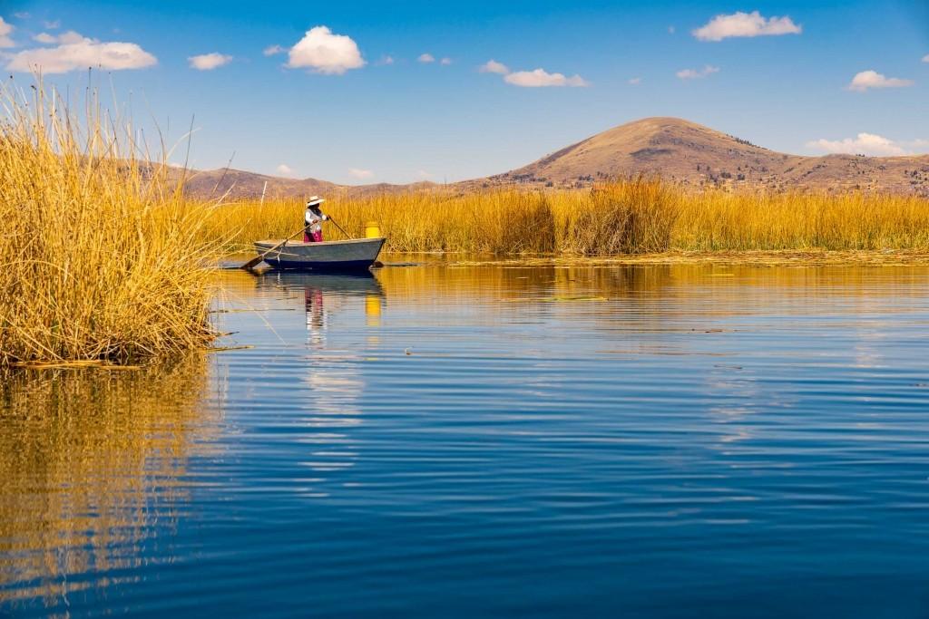 Uros Floating Islands Titicaca Lake Puno Peru reed worker boat
