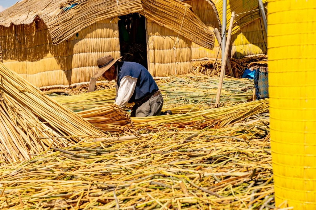 Uros Floating Islands Titicaca Lake Puno Peru reed worker